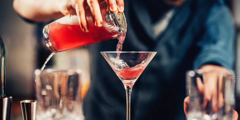 https://marbellaacademy.com/wp-content/uploads/close-up-details-of-barman-pouring-vodka-cosmopoli-PA7GCEU-scaled.jpg