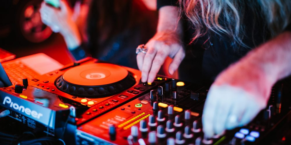 https://i0.wp.com/marbellaacademy.com/wp-content/uploads/digital-high-resolution-photograph-of-a-djs-hands-controlling-the-music-at-a-special-event-with-neon_t20_eVPNp7-1-scaled.jpg?fit=2560%2C1707&ssl=1
