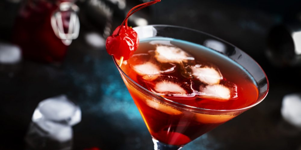https://i1.wp.com/marbellaacademy.com/wp-content/uploads/manhattan-alcoholic-cocktail-with-bourbon-red-vemu-L5NZHDW-scaled.jpg?fit=2560%2C1467&ssl=1